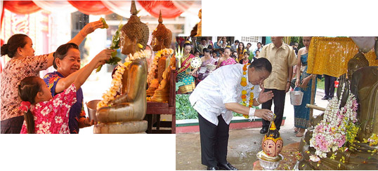 Lao New Year - Devotees clean buddha images with perfumed water